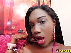 Black bikini tgirl jerking her dick on couch