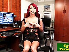 Heeled redhead ladyboy jerking her hard cock in solo session