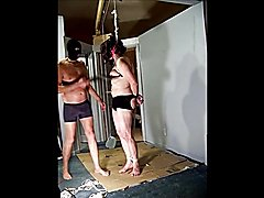 Transvestite kinky escort tied by the neck and tortured by her client.