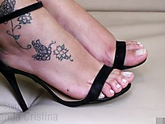 TGIRL Cristina has had a long day standing in her heels. Watch her remove them, and massage ...