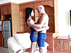 Raven-haired with alabaster skin, Ladyboy Benz is making out with her man in the living room...