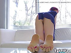 Pedicured TS debutante shows off her long toes during solo scene