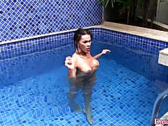 Sexy tranny takes bath in the pool She comes out of the pool and dries her naked body with a...