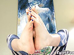 Trans debutante curls her toes after covering them with lotion