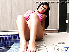 Sexy Ingrid loves to show off her sexy feet! Watch as she gets them wet in the pool, showing...