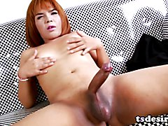 Evesa is a cute Asian shemale babe who enjoys stroking her hard cock and gets herself off.