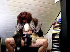 This lustful redhead shemale slut loves to look irresistible and today she is dressed in a v...
