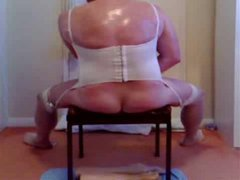 Look at this big fat crossdresser in a cute white underwear and stockings. Today he is havin...