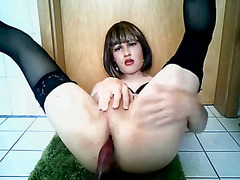 Insanely attractive young crossdresser toys her beautiful ass while jerking her gorgeous cli...
